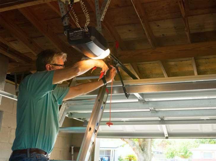 Man working on a garage door