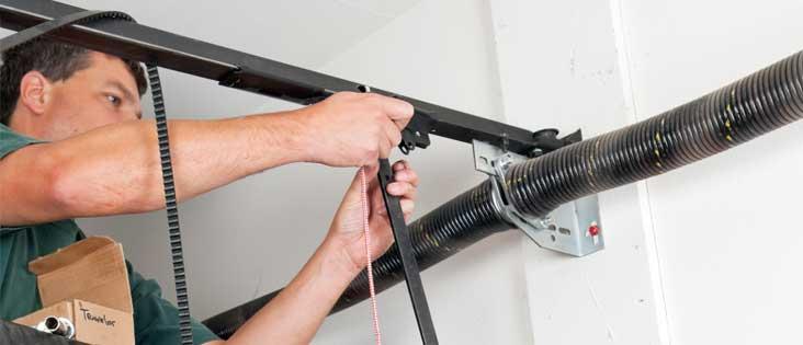 Man replacing a garage door