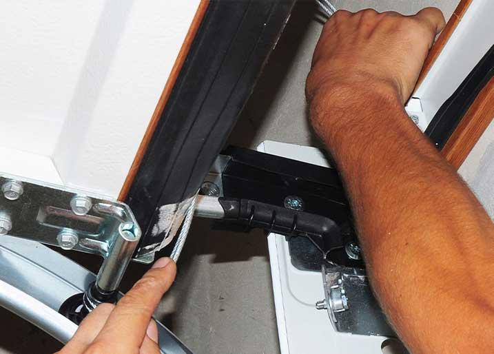 Man fixing a garage door
